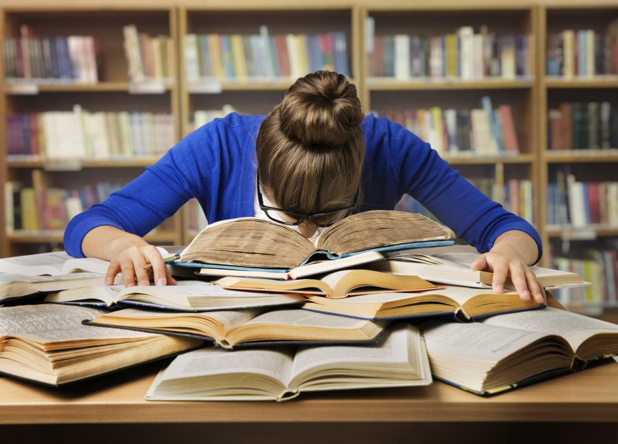 Student+Studying+Hard+Exam+and+Sleeping+on+Books%2C+Tired+Girl+Read+Difficult+Book+in+Library